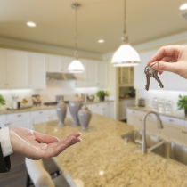 Handing Over New House Keys Inside Beautiful Custom Built Kitchen.
